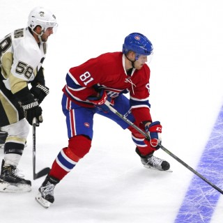 Sep 28, 2015; Quebec City, Quebec, CAN; Montreal Canadiens center Lars Eller (81) plays the puck against Pittsburgh Penguins defenseman Kris Letang (58) during the third period at Videotron Centre. Mandatory Credit: Jean-Yves Ahern-USA TODAY Sports