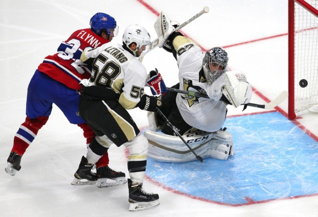 Sep 28, 2015; Quebec City, Quebec, CAN; Montreal Canadiens right wing Brian Flynn (32) shots and scores a goal against Pittsburgh Penguins goalie Marc-Andre Fleury (29) as defenseman Kris Letang (58) defends during the third period at Videotron Centre. Mandatory Credit: Jean-Yves Ahern-USA TODAY Sports