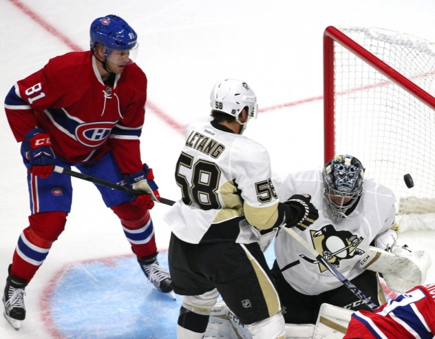 Sep 28, 2015; Quebec City, Quebec, CAN; Montreal Canadiens right wing Alexander Semin (13) (not pictured) scores a goal against Pittsburgh Penguins goalie Marc-Andre Fleury (29) as defenseman Kris Letang (58) defends and center Lars Eller (81) during the first period at Videotron Centre. Mandatory Credit: Jean-Yves Ahern-USA TODAY Sports