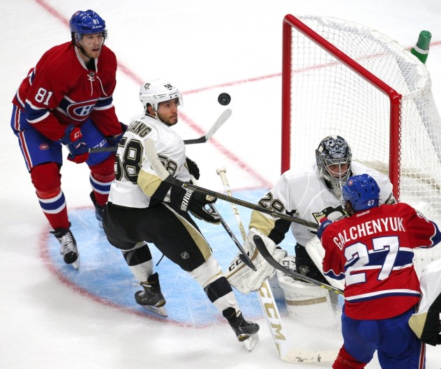Sep 28, 2015; Quebec City, Quebec, CAN; Montreal Canadiens center Alex Galchenyuk (27) shoots on Pittsburgh Penguins goalie Marc-Andre Fleury (29) as defenseman Kris Letang (58) defends and center Lars Eller (81) during the first period at Videotron Centre. Mandatory Credit: Jean-Yves Ahern-USA TODAY Sports