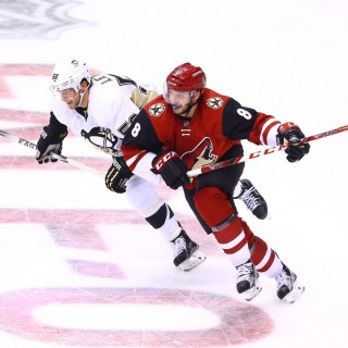 Oct 10, 2015; Glendale, AZ, USA; Arizona Coyotes center Tobias Rieder (8) battles for position against Pittsburgh Penguins defenseman Kris Letang (58) in the second period during the home opener at Gila River Arena. Mandatory Credit: Mark J. Rebilas-USA TODAY Sports