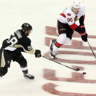 Oct 15, 2015; Pittsburgh, PA, USA; Pittsburgh Penguins defenseman Kris Letang (58) skates with the puck as Ottawa Senators right wing Alex Chiasson (90) defends during the third period at the CONSOL Energy Center. The Penguins won 2-0. Mandatory Credit: Charles LeClaire-USA TODAY Sports