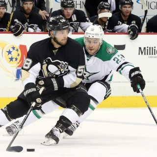 Oct 22, 2015; Pittsburgh, PA, USA; Pittsburgh Penguins defenseman Kris Letang (58) skates with the puck as Dallas Stars center Colton Sceviour (22) chases during the third period at the CONSOL Energy Center. The Stars won 4-1. Mandatory Credit: Charles LeClaire-USA TODAY Sports