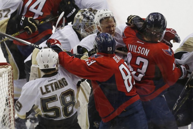 Oct 28, 2015; Washington, DC, USA; Washington Capitals right wing Tom Wilson (43) and Pittsburgh Penguins right wing Patric Hornqvist (72) scrum in the second period at Verizon Center. Mandatory Credit: Geoff Burke-USA TODAY Sports
