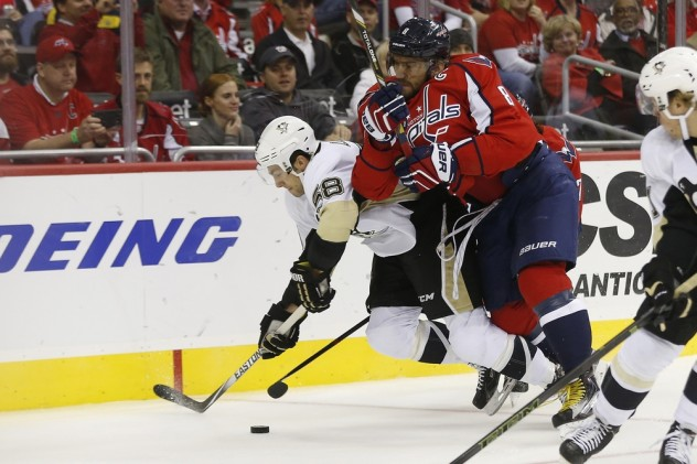 Oct 28, 2015; Washington, DC, USA; Washington Capitals left wing Alex Ovechkin (8) checks Pittsburgh Penguins defenseman Kris Letang (58) while battling for the puck in the first period at Verizon Center. Mandatory Credit: Geoff Burke-USA TODAY Sports