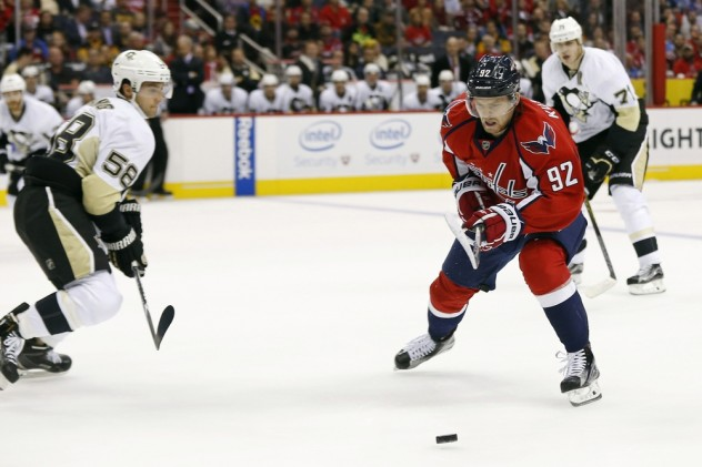 Oct 28, 2015; Washington, DC, USA; Washington Capitals center Evgeny Kuznetsov (92) skates with the puck as Pittsburgh Penguins defenseman Kris Letang (58) defends in the first period at Verizon Center. Mandatory Credit: Geoff Burke-USA TODAY Sports