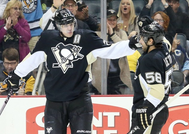 Nov 19, 2015; Pittsburgh, PA, USA; Pittsburgh Penguins center Evgeni Malkin (71) celebrates defenseman Kris Letang (58) after scoring a goal against the Colorado Avalanche during the second period at the CONSOL Energy Center. Mandatory Credit: Charles LeClaire-USA TODAY Sports