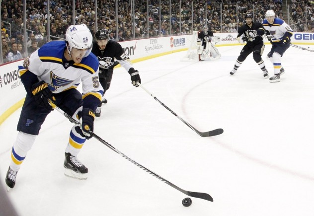 Nov 25, 2015; Pittsburgh, PA, USA; St. Louis Blues left wing Magnus Paajarvi (56) plays the puck in the corner as Pittsburgh Penguins defenseman Kris Letang (58) pressures during the third period at the CONSOL Energy Center. The Penguins won 4-3 in overtime. Mandatory Credit: Charles LeClaire-USA TODAY Sports