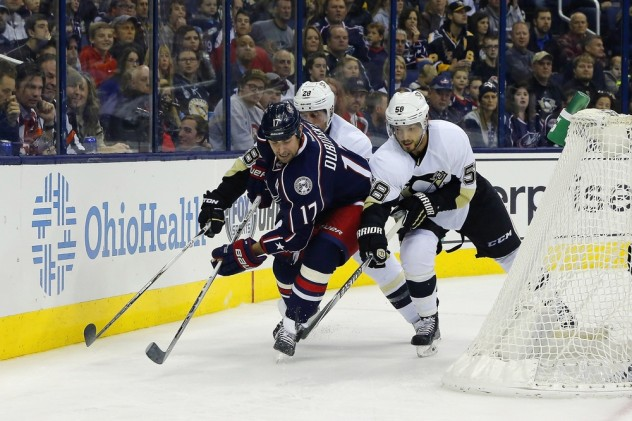 Nov 27, 2015; Columbus, OH, USA; Pittsburgh Penguins defenseman Kris Letang (58) steals the puck from Columbus Blue Jackets center Brandon Dubinsky (17) during the second period at Nationwide Arena. Mandatory Credit: Russell LaBounty-USA TODAY Sports