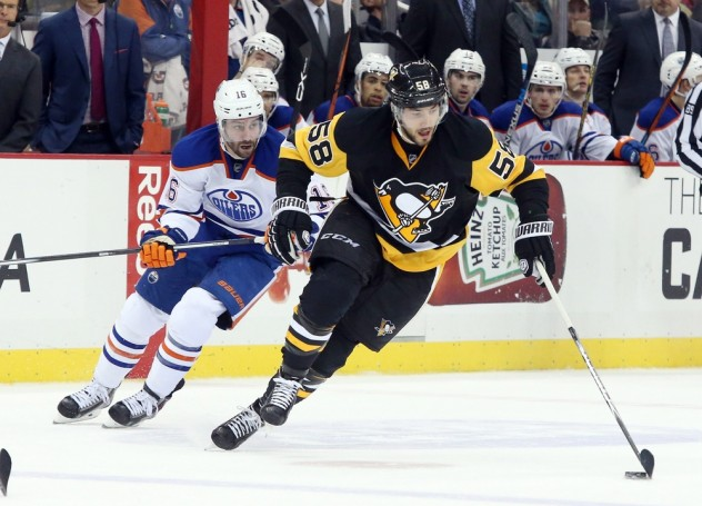 Nov 28, 2015; Pittsburgh, PA, USA; Pittsburgh Penguins defenseman Kris Letang (58) skates with the puck ahead of Edmonton Oilers right wing Teddy Purcell (16) during the second period  at the CONSOL Energy Center. The Oilers won 3-2 in a shootout. Mandatory Credit: Charles LeClaire-USA TODAY Sports