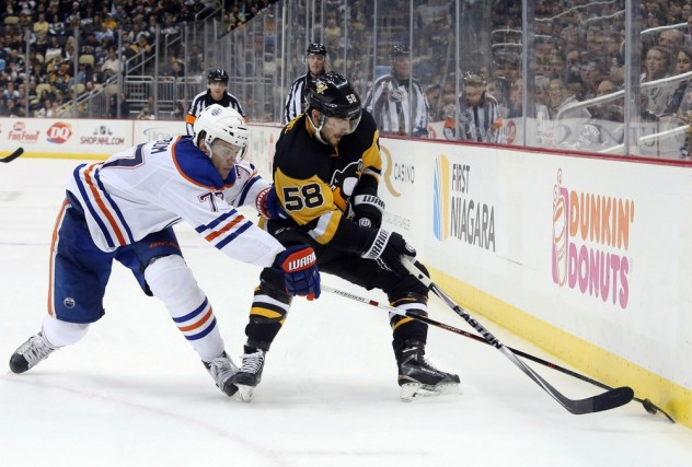 Nov 28, 2015; Pittsburgh, PA, USA; Edmonton Oilers defenseman Oscar Klefbom (77) and Pittsburgh Penguins defenseman Kris Letang (58) fight for the puck during the second period at the CONSOL Energy Center. The Oilers won 3-2 in a shootout. Mandatory Credit: Charles LeClaire-USA TODAY Sports