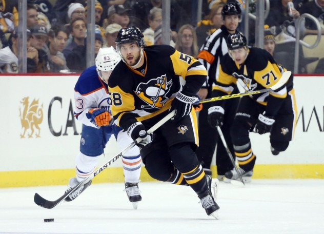 Nov 28, 2015; Pittsburgh, PA, USA; Pittsburgh Penguins defenseman Kris Letang (58) moves the puck up ice against the Edmonton Oilers during the second period at the CONSOL Energy Center. The Oilers won 3-2 in a shootout. Mandatory Credit: Charles LeClaire-USA TODAY Sports