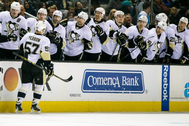 Dec 1, 2015; San Jose, CA, USA;  Pittsburgh Penguins left wing David Perron (57) celebrates with the bench after scoring against the San Jose Sharks in the third period at SAP Center at San Jose. The Penguins won 5-1. Mandatory Credit: John Hefti-USA TODAY Sports.
