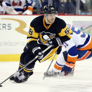 Jan 2, 2016; Pittsburgh, PA, USA; Pittsburgh Penguins defenseman Kris Letang (58) handles the puck against New York Islanders center Frans Nielsen (51) during the third period at the CONSOL Energy Center. The Penguins won 5-2. Mandatory Credit: Charles LeClaire-USA TODAY Sports