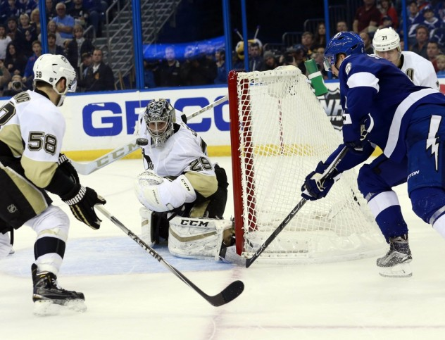 Jan 15, 2016; Tampa, FL, USA; Tampa Bay Lightning defenseman Anton Stralman (6) shoots as Pittsburgh Penguins goalie Marc-Andre Fleury (29) makes a save during overtime at Amalie Arena. Tampa Bay Lightning defeated the Pittsburgh Penguins 5-4. Mandatory Credit: Kim Klement-USA TODAY Sports