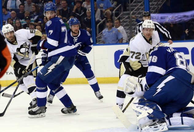 Jan 15, 2016; Tampa, FL, USA; Pittsburgh Penguins defenseman Kris Letang (58) shoots and scores on Tampa Bay Lightning goalie Andrei Vasilevskiy (88) during the first period at Amalie Arena. Mandatory Credit: Kim Klement-USA TODAY Sports