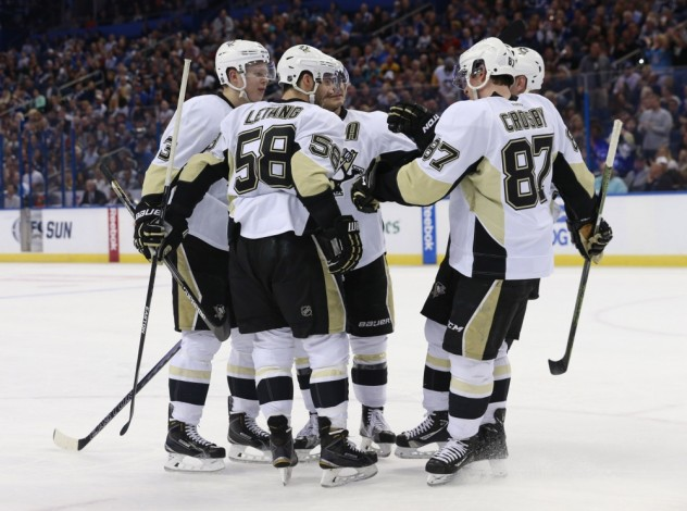 Jan 15, 2016; Tampa, FL, USA; Pittsburgh Penguins defenseman Kris Letang (58) is congratulated as he scores a goal against the Tampa Bay Lightning during the first period at Amalie Arena. Mandatory Credit: Kim Klement-USA TODAY Sports