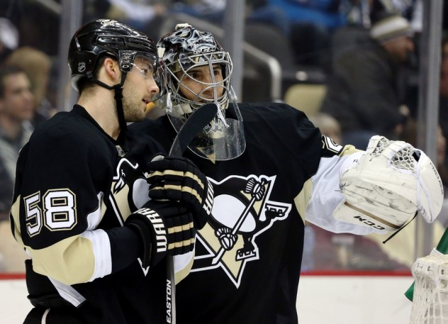 Jan 23, 2016; Pittsburgh, PA, USA; Pittsburgh Penguins defenseman Kris Letang (58) and goalie Marc-Andre Fleury (29) talk during a time-out against the Vancouver Canucks in the third period at the CONSOL Energy Center. The Penguins won 5-3. Mandatory Credit: Charles LeClaire-USA TODAY Sports