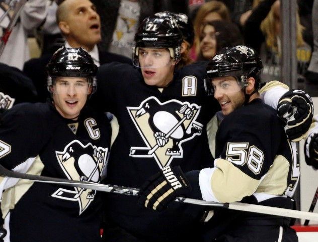 Jan 23, 2016; Pittsburgh, PA, USA; Pittsburgh Penguins center Sidney Crosby (87) and center Evgeni Malkin (71) and defenseman Kris Letang (58) celebrate after a gaol by Malkin against the Vancouver Canucks during the second period at the CONSOL Energy Center. Mandatory Credit: Charles LeClaire-USA TODAY Sports