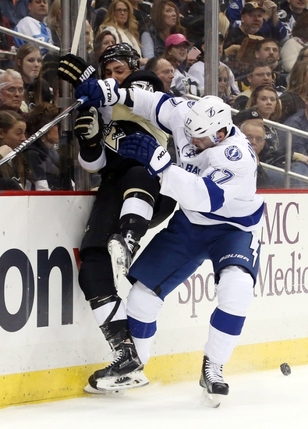 Feb 20, 2016; Pittsburgh, PA, USA; Tampa Bay Lightning center Alex Killorn (17) checks Pittsburgh Penguins defenseman Kris Letang (58) during the first period at the CONSOL Energy Center. Mandatory Credit: Charles LeClaire-USA TODAY Sports