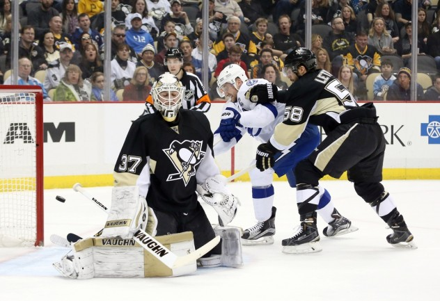 Feb 20, 2016; Pittsburgh, PA, USA; Tampa Bay Lightning center Steven Stamkos (middle) scores behind Pittsburgh Penguins goalie Jeff Zatkoff (37) as Pens defenseman Kris Letang (58) defends during the first period at the CONSOL Energy Center. The goal was the 300th career NHL goal for Stamkos. Tampa Bay won 4-2. Mandatory Credit: Charles LeClaire-USA TODAY Sports