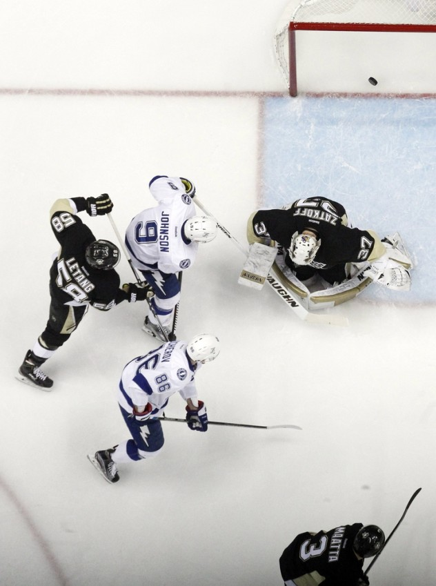 Feb 20, 2016; Pittsburgh, PA, USA; Pittsburgh Penguins defenseman Kris Letang (58) and Tampa Bay Lightning center Tyler Johnson (9) and right wing Nikita Kucherov (86) watch a shot by Lightning defenseman Matt Carle (not pictured) score behind Pens goalie Jeff Zatkoff (37) during the second period at the CONSOL Energy Center. Tampa Bay won 4-2. Mandatory Credit: Charles LeClaire-USA TODAY Sports