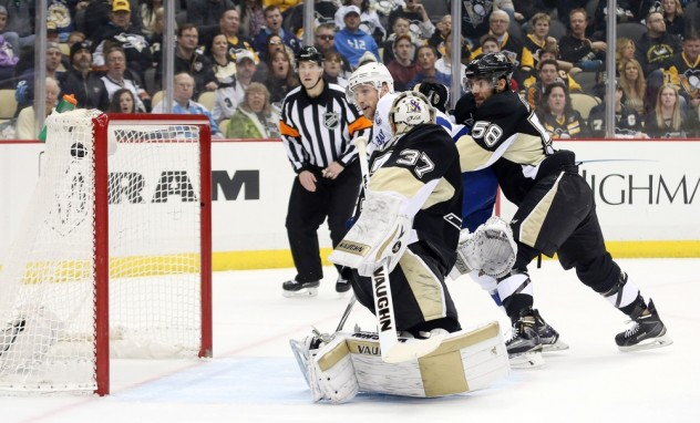 Feb 20, 2016; Pittsburgh, PA, USA; Tampa Bay Lightning center Steven Stamkos (middle) scores behind Pittsburgh Penguins goalie Jeff Zatkoff (37) as Pens defenseman Kris Letang (58) defends during the first period at the CONSOL Energy Center. The goal was the 300th career NHL goal for Stamkos. Mandatory Credit: Charles LeClaire-USA TODAY Sports