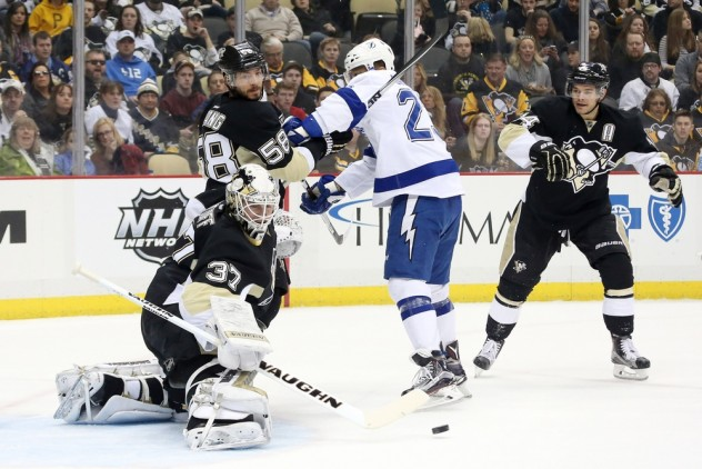 Feb 20, 2016; Pittsburgh, PA, USA; Pittsburgh Penguins goalie Jeff Zatkoff (37) makes a save as Penguins defenseman Kris Letang (58) defends Tampa Bay Lightning right wing J.T. Brown (23) during the first period at the CONSOL Energy Center. Mandatory Credit: Charles LeClaire-USA TODAY Sports