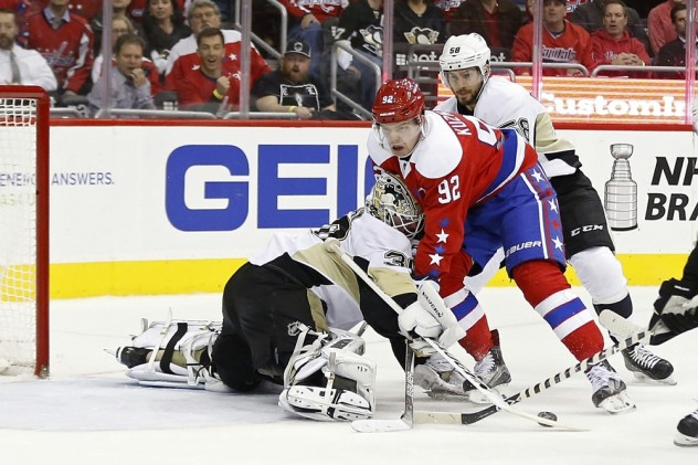 Apr 7, 2016; Washington, DC, USA; Pittsburgh Penguins goalie Matt Murray (30) makes a save on Washington Capitals center Evgeny Kuznetsov (92) in the first period at Verizon Center. Mandatory Credit: Geoff Burke-USA TODAY Sports
