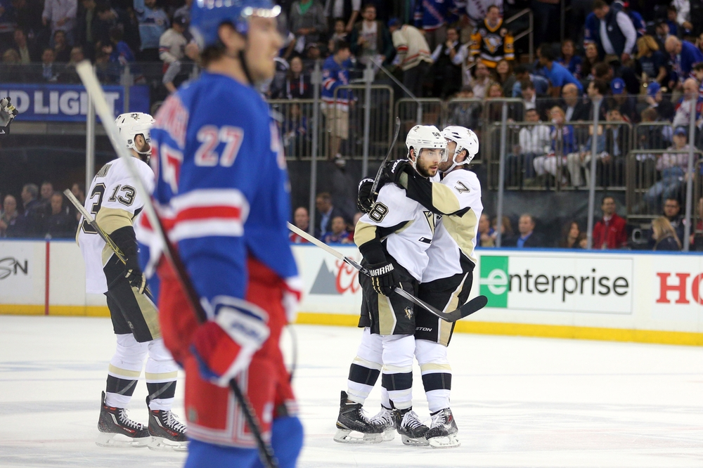 Apr 19, 2016; New York, NY, USA; Pittsburgh Penguins defenseman Kris Letang (58) celebrates his empty-net goal with Pittsburgh Penguins center Matt Cullen (7) in front of New York Rangers defenseman Ryan McDonagh (27) during the third period of game three of the first round of the 2016 Stanley Cup Playoffs at Madison Square Garden. The Penguins defeated the Rangers 3-1 to take a two games to one lead in the best of seven series. Mandatory Credit: Brad Penner-USA TODAY Sports