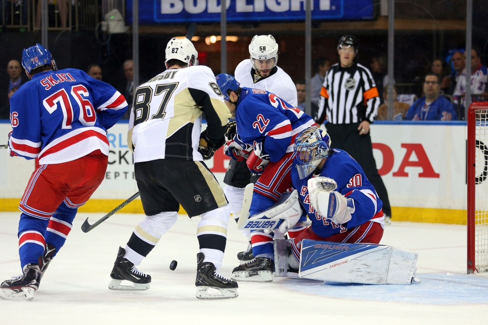 Apr 19, 2016; New York, NY, USA; New York Rangers goalie Henrik Lundqvist (30) makes a save in front of Pittsburgh Penguins center Sidney Crosby (87) and New York Rangers defenseman Dan Boyle (22) during the first period of game three of the first round of the 2016 Stanley Cup Playoffs at Madison Square Garden. Mandatory Credit: Brad Penner-USA TODAY Sports