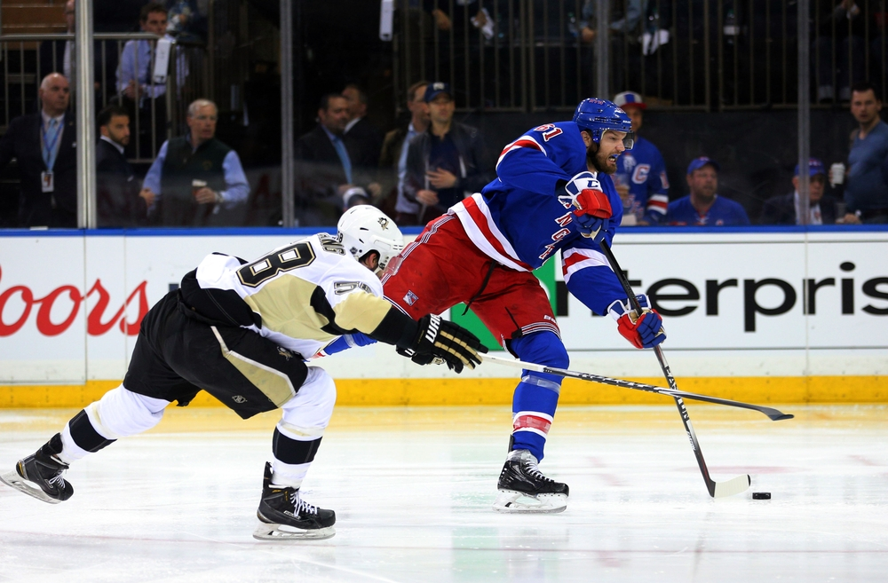 Apr 19, 2016; New York, NY, USA; New York Rangers left wing Rick Nash (61) beats Pittsburgh Penguins defenseman Kris Letang (58) and scores shorthanded goal during the second period of game three of the first round of the 2016 Stanley Cup Playoffs at Madison Square Garden. Mandatory Credit: Brad Penner-USA TODAY Sports