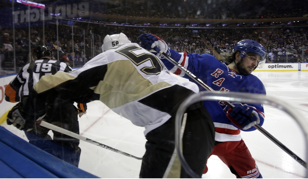 Apr 21, 2016; New York, NY, USA; New York Rangers right wing Mats Zuccarello (36) battling Pittsburgh Penguins defenseman Kris Letang (58) at the boards during the second period in game four of the first round of the 2016 Stanley Cup Playoffs at Madison Square Garden. Mandatory Credit: Adam Hunger-USA TODAY Sports