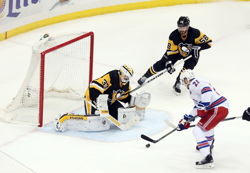 Apr 23, 2016; Pittsburgh, PA, USA; Pittsburgh Penguins goalie Matt Murray (30) makes a save against New York Rangers center Derek Stepan (21) during the third period in game five of the first round of the 2016 Stanley Cup Playoffs at the CONSOL Energy Center. The Pens won 6-3 to win the series 4-1. Mandatory Credit: Charles LeClaire-USA TODAY Sports