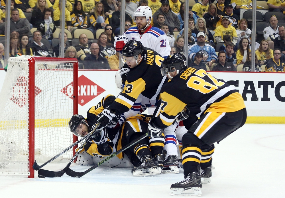 Apr 23, 2016; Pittsburgh, PA, USA; Pittsburgh Penguins defenseman Kris Letang (58) and defenseman Olli Maatta (3) and center Sidney Crosby (87) reach to keep the puck from crossing the goal line against the New York Rangers during the third period in game five of the first round of the 2016 Stanley Cup Playoffs at the CONSOL Energy Center. The Pens won 6-3. Mandatory Credit: Charles LeClaire-USA TODAY Sports