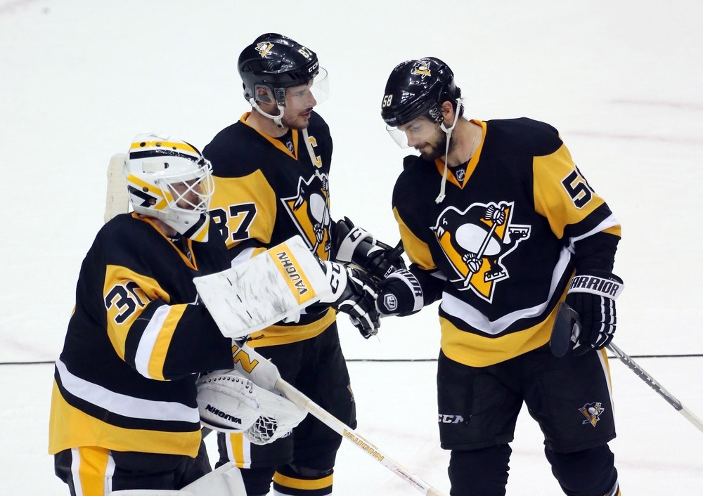 Apr 23, 2016; Pittsburgh, PA, USA; Pittsburgh Penguins goalie Matt Murray (30) and center Sidney Crosby (87) and defenseman Kris Letang (58) celebrate after defeating the New York Rangers 6-3 in game five of the first round of the 2016 Stanley Cup Playoffs at the CONSOL Energy Center. Mandatory Credit: Charles LeClaire-USA TODAY Sports