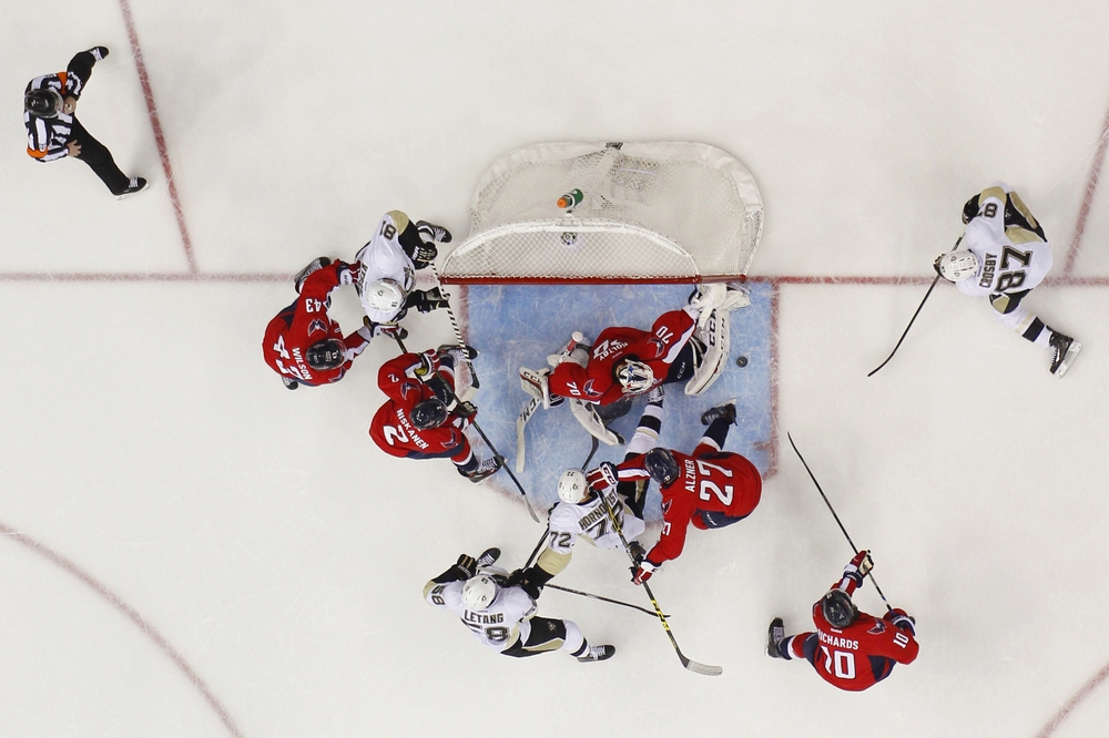 Apr 28, 2016; Washington, DC, USA; Washington Capitals goalie Braden Holtby (70) makes a save on Pittsburgh Penguins center Sidney Crosby (87) in the first period in game one of the second round of the 2016 Stanley Cup Playoffs at Verizon Center. The Capitals won 4-3 in overtime. Mandatory Credit: Geoff Burke-USA TODAY Sports