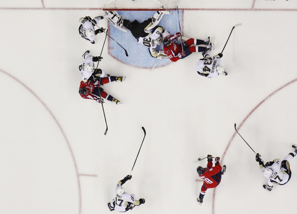 Apr 30, 2016; Washington, DC, USA; Washington Capitals defenseman Nate Schmidt (88) scores a goal as Washington Capitals center Evgeny Kuznetsov (92) bumps into Pittsburgh Penguins goalie Matt Murray (30) in the second period in game two of the second round of the 2016 Stanley Cup Playoffs at Verizon Center. The goal was disallowed and Kuznetsov was called for goalie interference on the play. The Penguins won 2-1, and the series is tied 1-1. Mandatory Credit: Geoff Burke-USA TODAY Sports