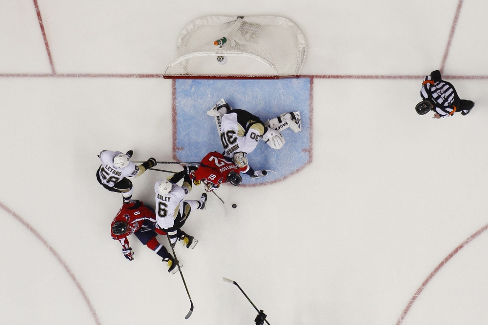 Apr 30, 2016; Washington, DC, USA; Washington Capitals center Evgeny Kuznetsov (92) reaches for the puck in front of Pittsburgh Penguins goalie Matt Murray (30) in the second period in game two of the second round of the 2016 Stanley Cup Playoffs at Verizon Center. The Penguins won 2-1, and the series is tied 1-1. Mandatory Credit: Geoff Burke-USA TODAY Sports