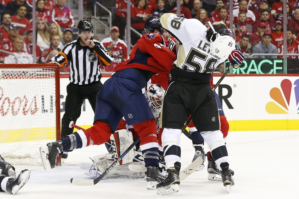 Apr 30, 2016; Washington, DC, USA; Washington Capitals defenseman Brooks Orpik (44) punches Pittsburgh Penguins defenseman Kris Letang (58) in the second period in game two of the second round of the 2016 Stanley Cup Playoffs at Verizon Center. Mandatory Credit: Geoff Burke-USA TODAY Sports