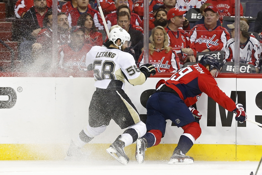 May 7, 2016; Washington, DC, USA; Pittsburgh Penguins defenseman Kris Letang (58) checks Washington Capitals center Nicklas Backstrom (19) in the first period in game five of the second round of the 2016 Stanley Cup Playoffs at Verizon Center. The Capitals won 3-1 as the Penguins lead the series 3-2. Mandatory Credit: Geoff Burke-USA TODAY Sports