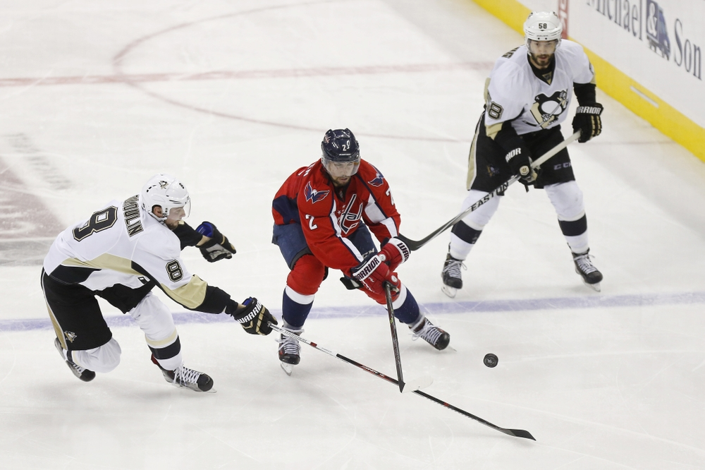 May 7, 2016; Washington, DC, USA; Washington Capitals defenseman Matt Niskanen (2) and Pittsburgh Penguins defenseman Brian Dumoulin (8) battle for the puck in the third period in game five of the second round of the 2016 Stanley Cup Playoffs at Verizon Center. The Capitals won 3-1 as the Penguins lead the series 3-2. Mandatory Credit: Geoff Burke-USA TODAY Sports