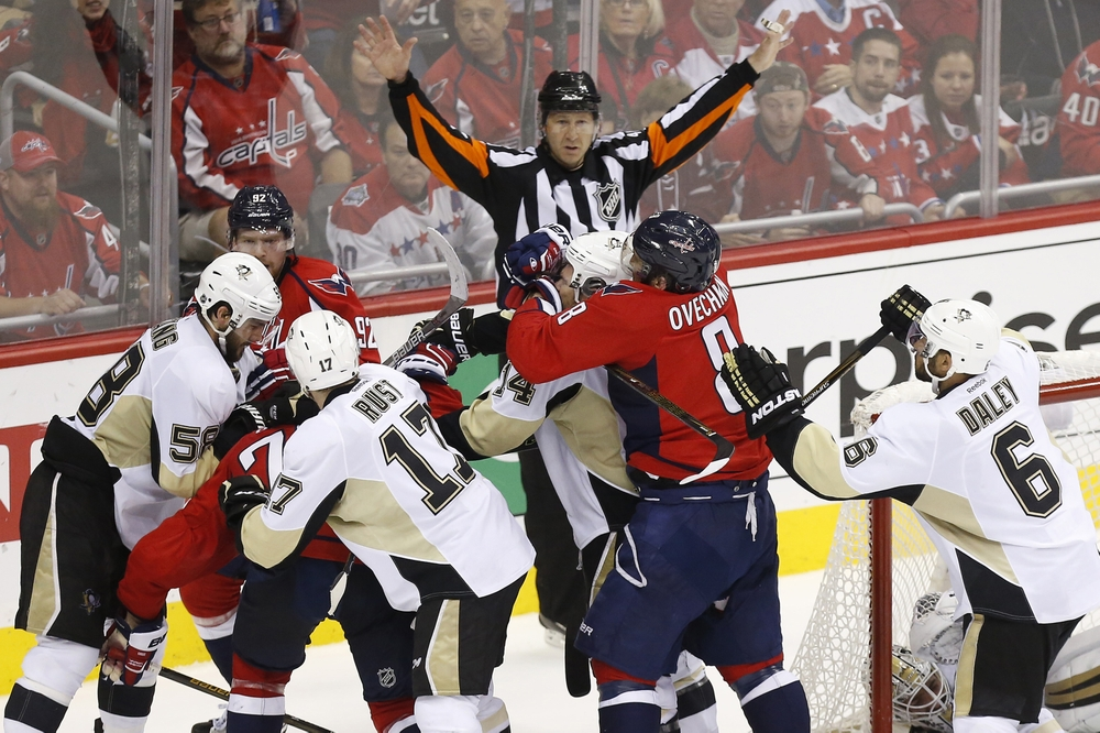 May 7, 2016; Washington, DC, USA; Washington Capitals left wing Alex Ovechkin (8) grabs Pittsburgh Penguins left wing Chris Kunitz (14) during a scrum after a whistle in the third period in game five of the second round of the 2016 Stanley Cup Playoffs at Verizon Center. The Capitals won 3-1 as the Penguins lead the series 3-2. Mandatory Credit: Geoff Burke-USA TODAY Sports