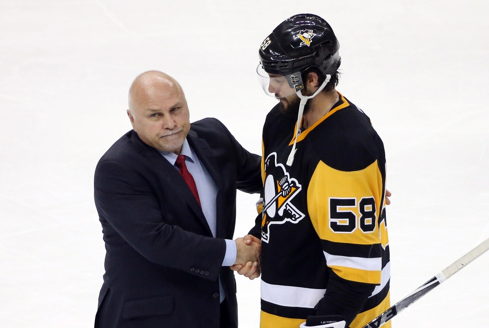 May 10, 2016; Pittsburgh, PA, USA; Washington Capitals head coach Barry Trotz (L) and Pittsburgh Penguins defenseman Kris Letang (58) shake hands after game six of the second round of the 2016 Stanley Cup Playoffs at the CONSOL Energy Center. The Pens won 4-3 in overtime to win the series 4 games to 2. Mandatory Credit: Charles LeClaire-USA TODAY Sports