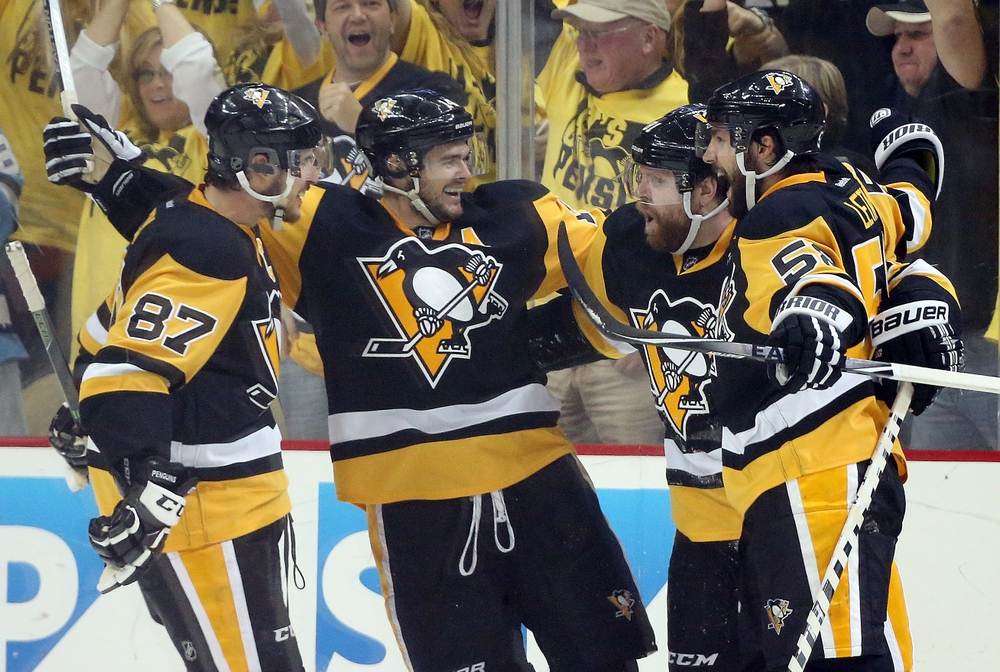 May 10, 2016; Pittsburgh, PA, USA; Pittsburgh Penguins center Sidney Crosby (87) and left wing Chris Kunitz (14) and defenseman Kris Letang (58) congratulate right wing Phil Kessel (RC) after Kessel scored his second goal of the game against the Washington Capitals during the second period in game six of the second round of the 2016 Stanley Cup Playoffs at the CONSOL Energy Center. Mandatory Credit: Charles LeClaire-USA TODAY Sports