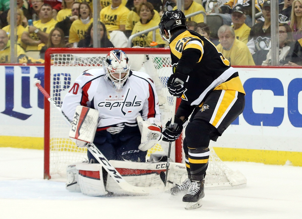May 10, 2016; Pittsburgh, PA, USA; Washington Capitals goalie Braden Holtby (70) makes a save against Pittsburgh Penguins defenseman Kris Letang (58) during the first period in game six of the second round of the 2016 Stanley Cup Playoffs at the CONSOL Energy Center. Mandatory Credit: Charles LeClaire-USA TODAY Sports