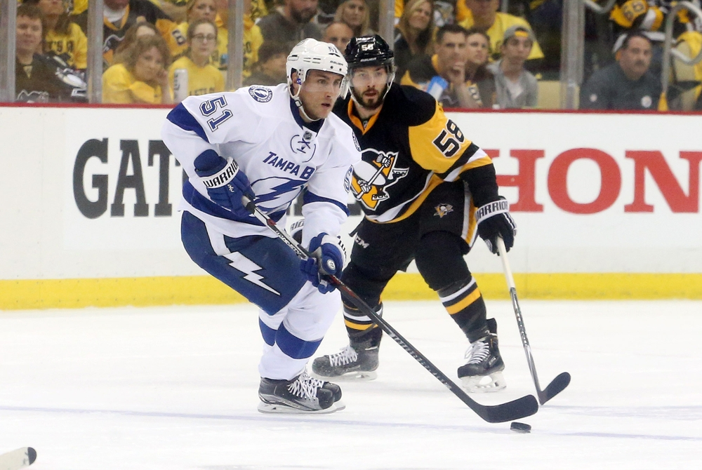 May 13, 2016; Pittsburgh, PA, USA; Tampa Bay Lightning center Valtteri Filppula (51) skates with the puck as Pittsburgh Penguins defenseman Kris Letang (58) defends during the second period in game one of the Eastern Conference Final of the 2016 Stanley Cup Playoffs at the CONSOL Energy Center. The Lightning won 3-1. Mandatory Credit: Charles LeClaire-USA TODAY Sports
