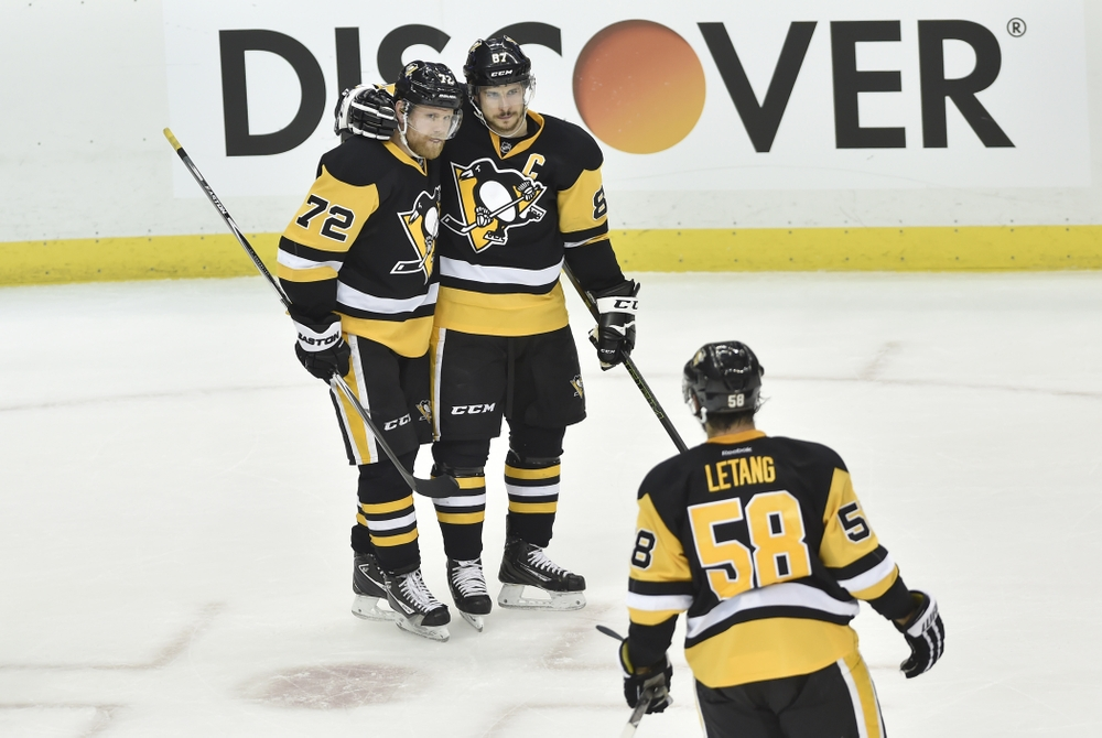 May 13, 2016; Pittsburgh, PA, USA; Pittsburgh Penguins right wing Patric Hornqvist (72) celebrates with Sidney Crosby (87) and Kris Letang (58) after scoring a goal against the Tampa Bay Lightning during the second period in game one of the Eastern Conference Final of the 2016 Stanley Cup Playoffs at CONSOL Energy Center. Mandatory Credit: Don Wright-USA TODAY Sports