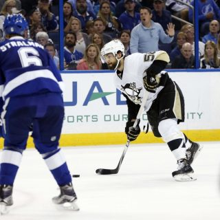 May 18, 2016; Tampa, FL, USA; Pittsburgh Penguins defenseman Kris Letang (58) shoots as Tampa Bay Lightning defenseman Anton Stralman (6) defends during the second period of game three of the Eastern Conference Final of the 2016 Stanley Cup Playoffs at Amalie Arena. Mandatory Credit: Kim Klement-USA TODAY Sports