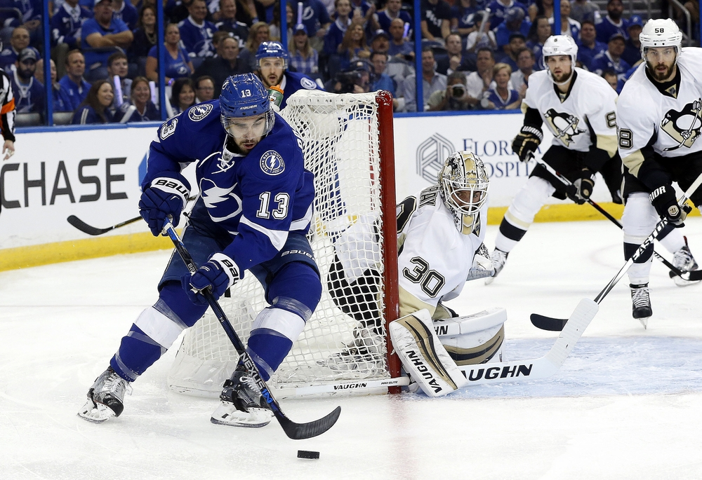 May 18, 2016; Tampa, FL, USA; Tampa Bay Lightning center Cedric Paquette (13) skates with the puck as Pittsburgh Penguins goalie Matt Murray (30) defends during the first period of game three of the Eastern Conference Final of the 2016 Stanley Cup Playoffs at Amalie Arena. Mandatory Credit: Kim Klement-USA TODAY Sports